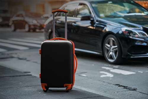 Airport Luggage and Black Car